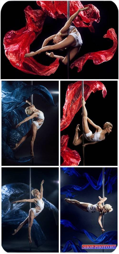 Девушка танцует у шеста, стриптиз / Girl dancing striptease - Stock photo