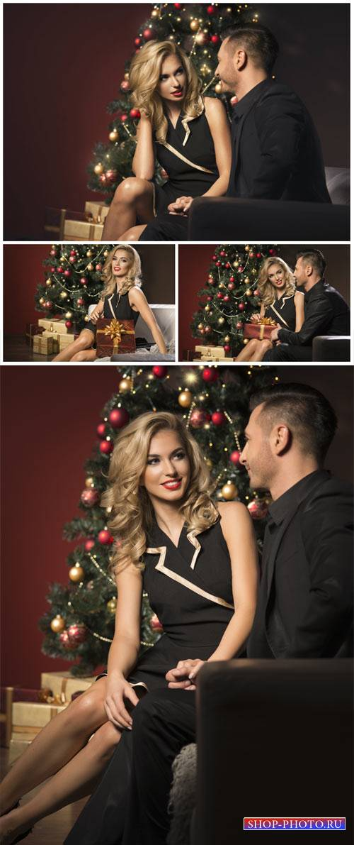 Couple in love at Christmas tree - Stock Photo