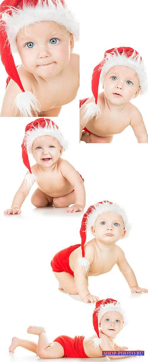 New Year`s baby, baby in santa hat - stock photos
