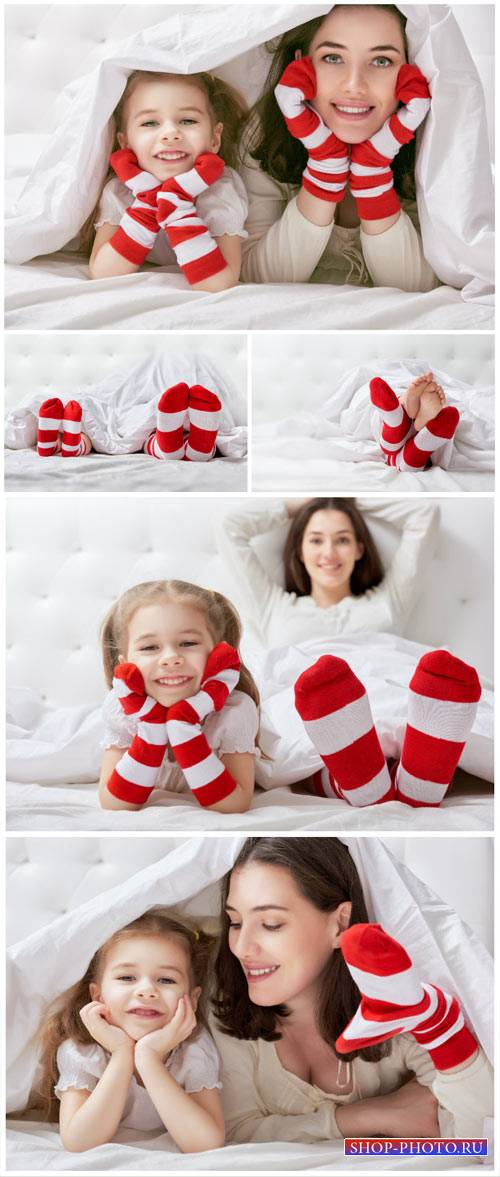 Mother and daughter on the bed - Stock Photo