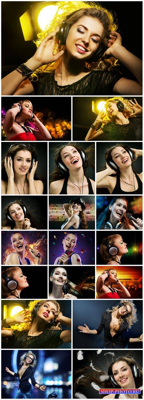 Girl in headphones listens to music - Stock Photo