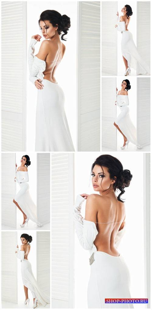 Charming girl in a long white dress - stock photos