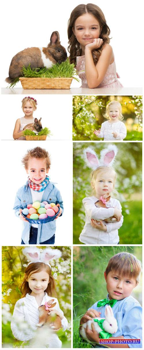 Little children and easter bunnies - Stock Photo