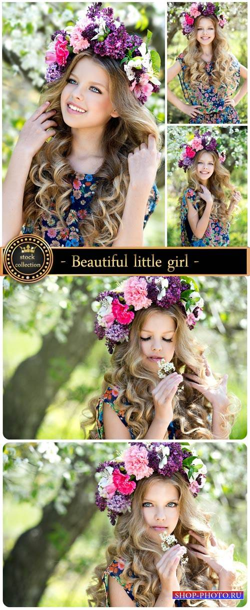 Beautiful little girl in a wreath - Stock photo