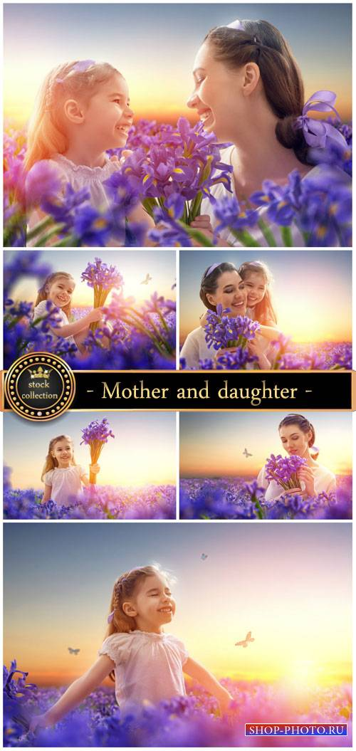Mother and daughter on the field with iris - Stock Photo